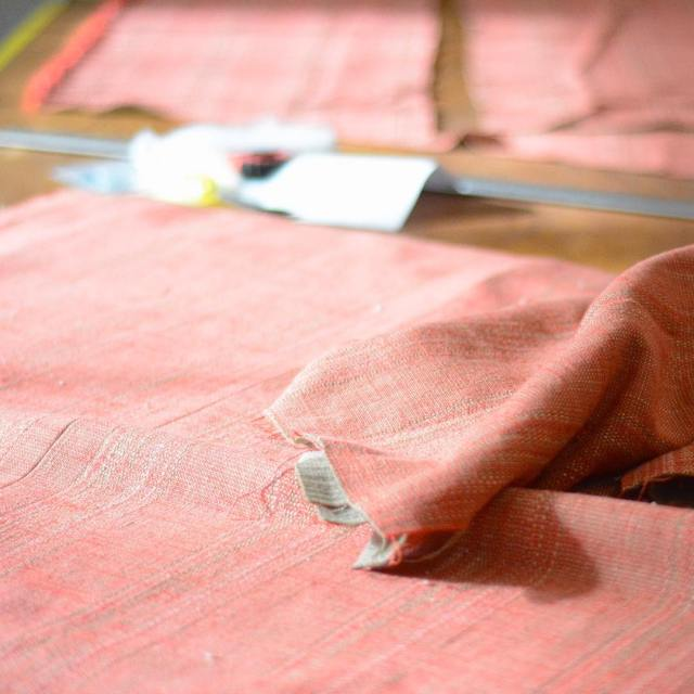 "Starting the week in the #workroom with this gorgeous intricate woven red linen, ""Harrison,"" from #colefaxandfowler. #tuesdayismymonday"