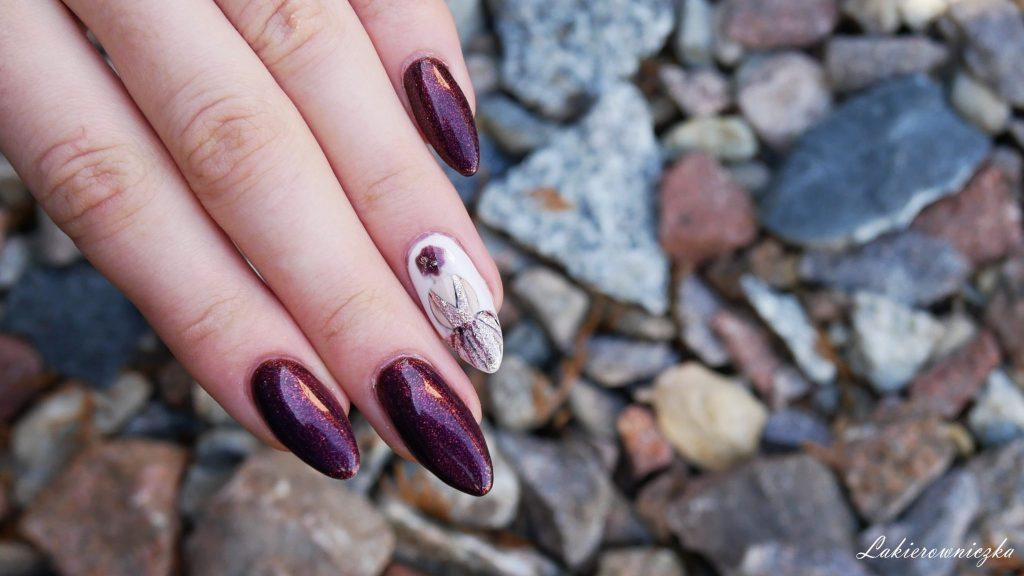 hybrydy-Wibo-Ruby-Opal-Pyrite-hybryda-paznokcie-hybrydowe-zdobienie-pani-kobieta-stojaca-tylem-Lakierowniczka