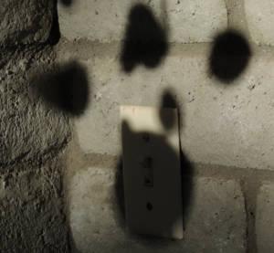 cat print shadow against wall