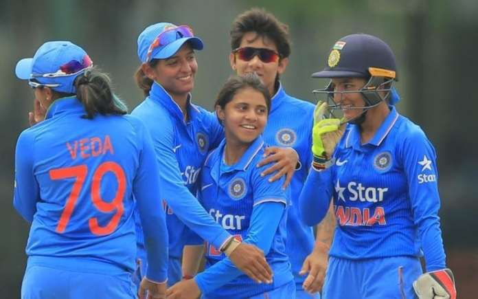 Indian women cricket team celebrating after taking wicket