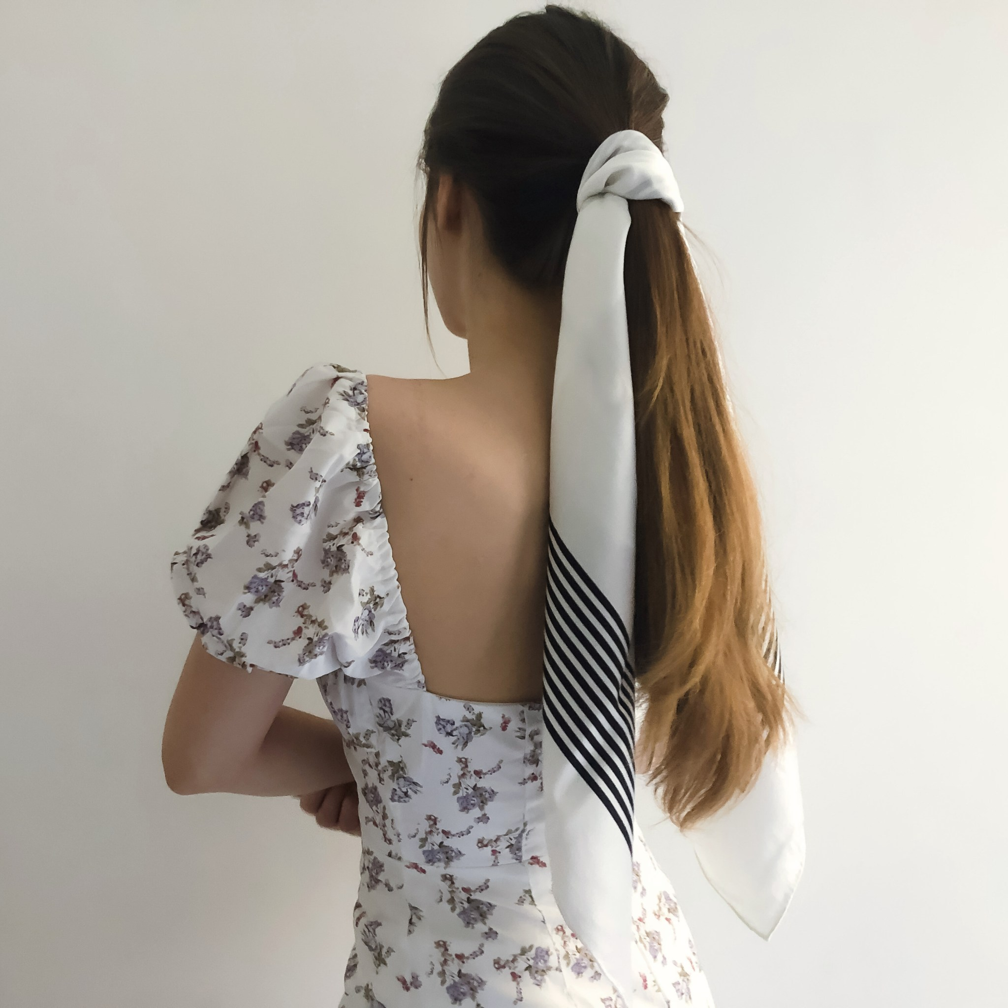 Lalouette white striped square silk scarf tied in hair