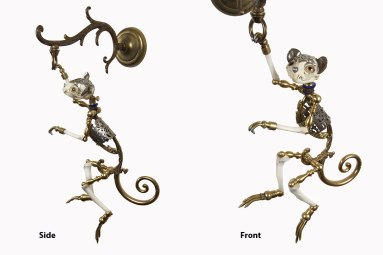 """Antique hardware and pierced silver, brass, bone, velvet and vestment trim, steel, glove leather, glass eyes. 20"""" x 9"""" x 10"""" $7,000.00"""