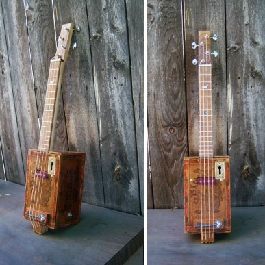 "Vintage Cigarbox, flame maple-koa neck,15 frets, 17"" scale Ted Crocker ""stonehenge"" pick-ups, Grover machines 24.5"" x 5.5"" x 6"" $1,200.00"