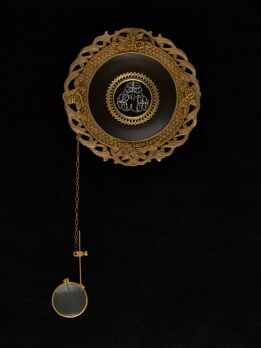 """Oil on metal with chain and magnifying glass 4"""" x 4"""" $300.00 Sold"""