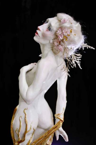 4 x 14 x 3 in. Polymer Clay, acrylic paint, mohair, glass beads, paper flowers, foliage and gold leaf. (close-up). $800.00