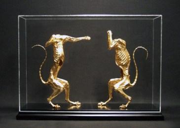 """Gold-leafed esodermy squirrels on black lacquer base. Enclosed under 19""""L x 13""""H x 5""""W plexiglass case, $3,200.00"""