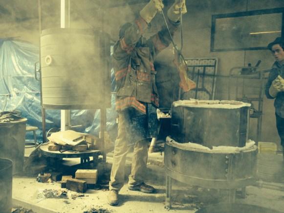 Don Fritz pulling Rocket Car from the kiln at his studio