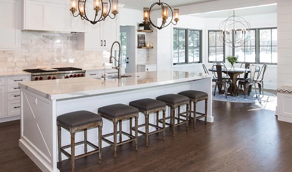 custom kitchen islands remodels under 5000 what to know for your remodel with dark wood floors white cabinets and an impressive focal point