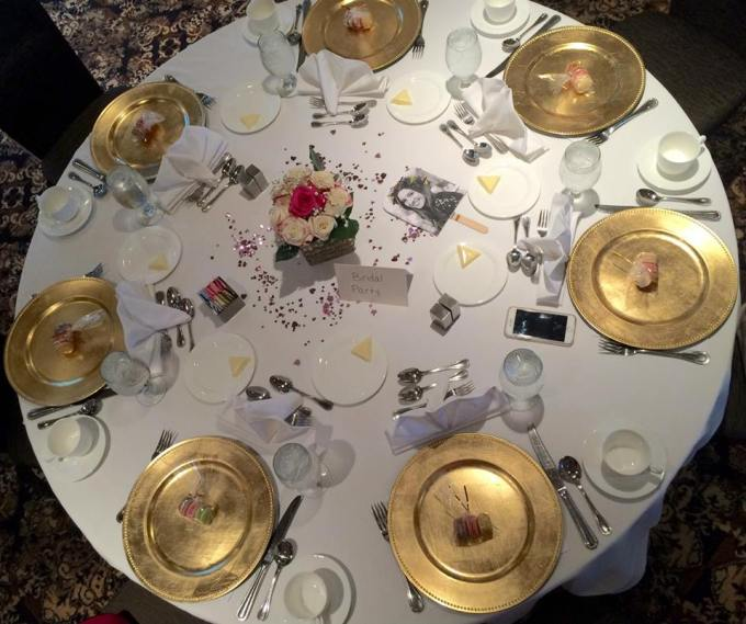 Bridal Shower Tables with Macaroons and gold charger plates