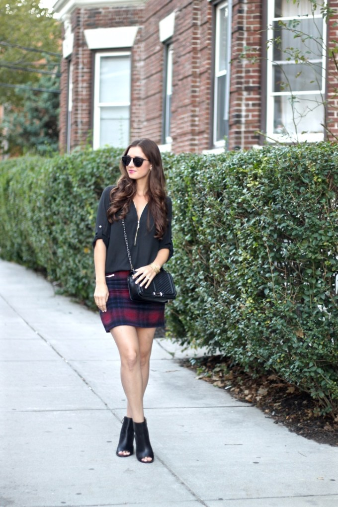 Navy and Red Plaid Skirt; Zip Front Black Blouse; Rebecca Minkoff Quilted chevron Bag; BCBG Black Peep-toe Booties