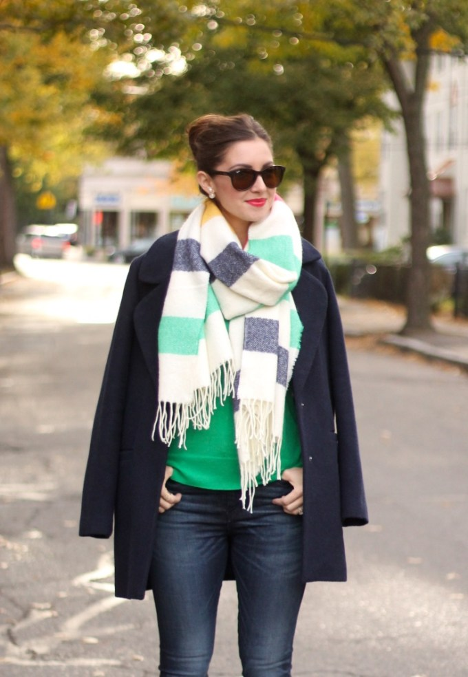 Multi-striped blanket scarf, green cardigan sweater, navy blue car coat