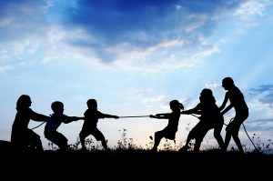 hope bigstock-Kids-playing-tug-war-pulling-r-38586121