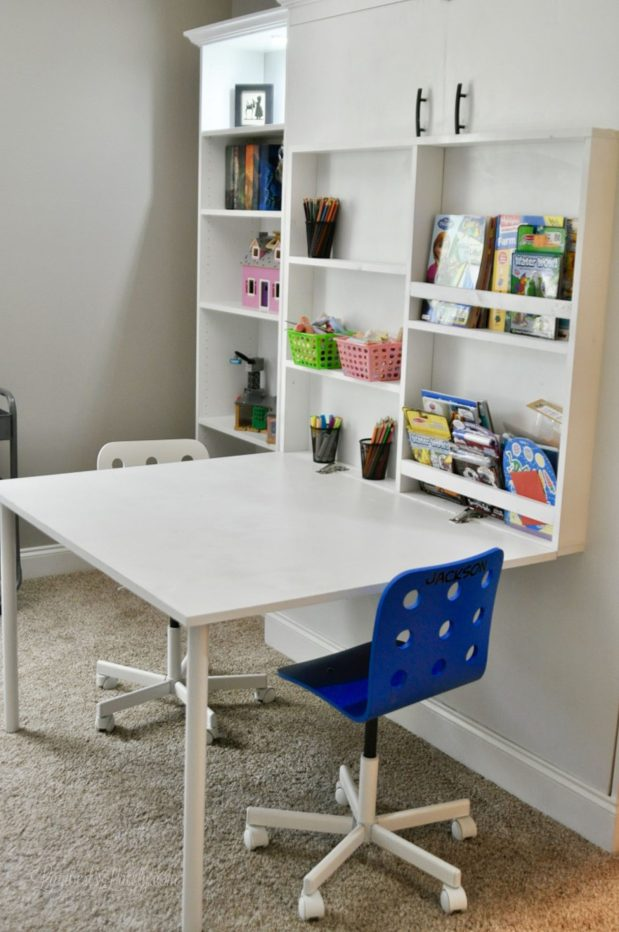 This DIY murphy bed with deskand bookcase combo is all made from inexpensive pieces! Includes Ikea Billy Bookcases and full plans for adding to your guest bedroom, office, or craft room.