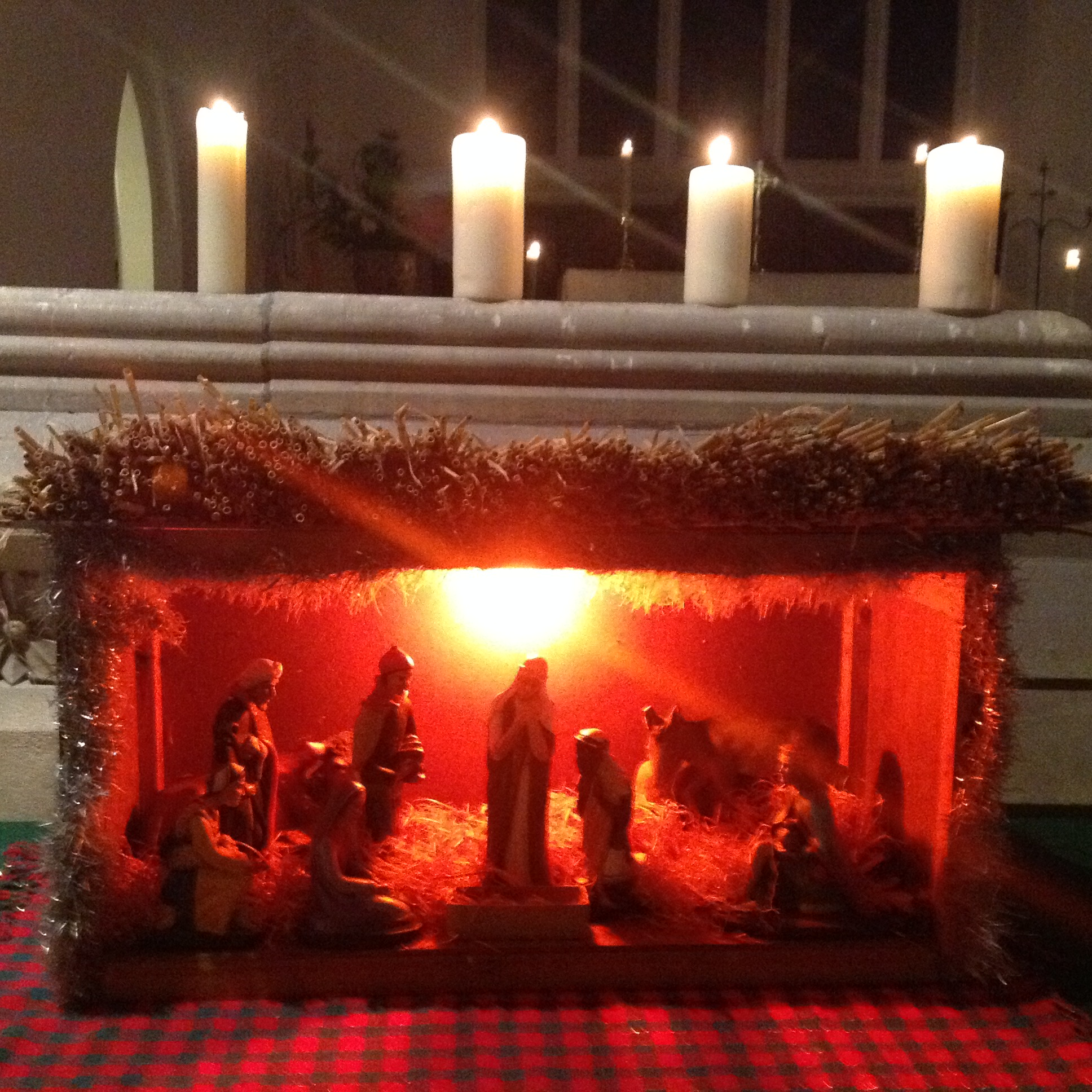 The nativity stable lit with candles