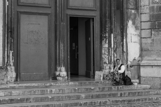 Homeless woman in front of Aix Cathedral