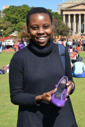 """Takatso Mohlakoana, 3rd year BA, Bought her shoes in Munich, back in 2008. """"At the time colourful shoes were really fashionable, I don't know why I've kept them for so long."""" Photo: Lameez Omarjee"""