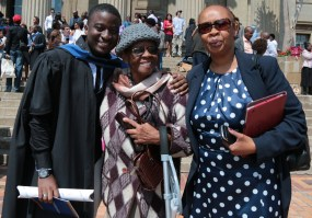 CHARMING: Bienvenu Ndagano poses with the ladies in his life, his mum and grandmother. Photo: Lameez Omarjee