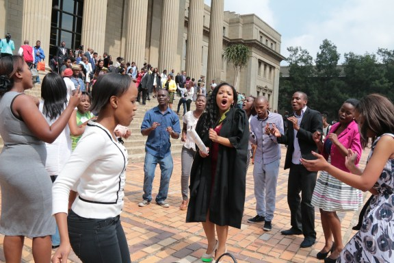 JOYOUS CELEBRATION: A graduate is surrounded by her friends, celebrating with song and dance. Photo: Lameez Omarjee