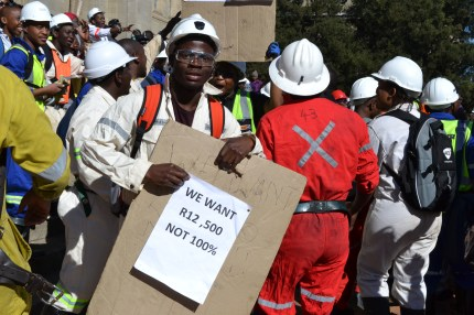 REMEMBERING MARIKANA: Wits mining students commemorate Marikana with placards with the same plight of miners in 2012. Photo: Lameez Omarjee