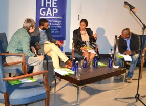 HOT SEATS: The speakers of the night settle in before the discussion about whether a national minimum wage will be enough to create equality in society. Photo: Lameez Omarjee