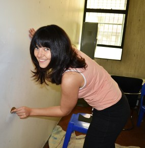 ROUGH EDGES: The group had their work cut out for them, having to sand walls. SEBS school council secretary Jinel Fourie put her nails to the test. Photo: Lameez Omarjee