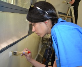 FINE TUNING: SEBS school council chairperson, Erin Roman added some finishing touches to one of the classrooms. Photo: Lameez Omarjee