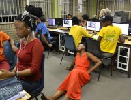 JUST LIKE HOME: Wits students working in the CNS computer labs at Senate House were confused by masters students demonstrating sleeping in labs for a project in the course theatre as activism, education and therapy. Photo: Lameez Omarjee