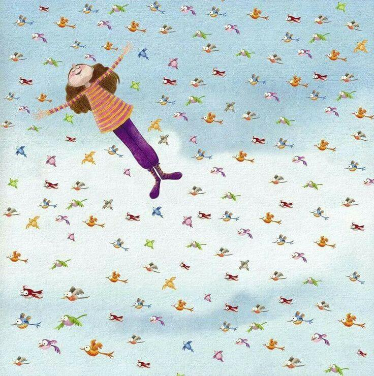 Mujer feliz volando con pájaros