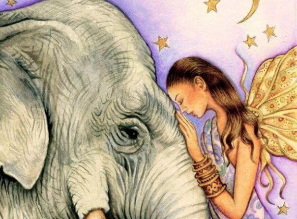 mujer con elefante pensando en hacer el bien
