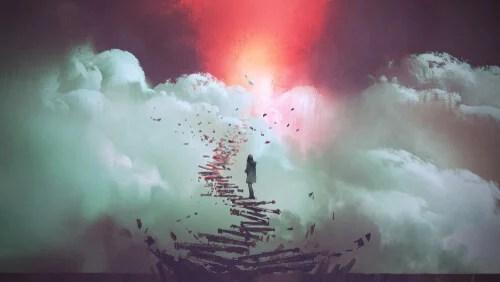 Persona subiendo escaleras al cielo