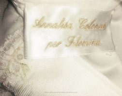 (B)Custom and embroidered label with the bride's name and designer's name