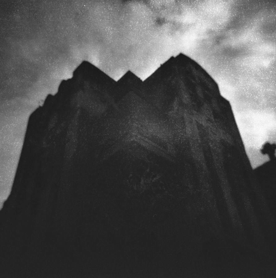 daniel battiston blogs photography film photography holga 120N 120 N analogue lomo lomography film not dead medium format  toy camera plastic camera plastic lenses argentic argentique cemetery graveyard architecture white and black wb tomb la loma mar del plata tower stones sky clouds cloudy art
