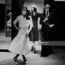 Designer Yves Saint Laurent with his assistant, Loulou de la Falaise (left), and his New York assistant, Marina Schiano, wearing his designs: Loulou, wearing a white crepe pleated dress with short sleeves, belted at waist, a black straw hat and silky scarf tied at the neck; Marina, wearing a middy with loose short sleeves and gathered skirt in cotton poplin, with white gob hat *** Local Caption *** Yves Saint Laurent;Loulou de la Falaise;Marina Schiano;
