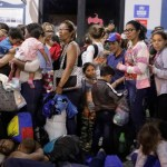 Venezuelan migrants wait at the Binational Border Service Center of Peru in Tumbes