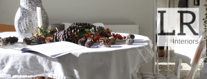 Lana rose Interiors Home Page image, table beautifully styled with linen and autumn cones and berries
