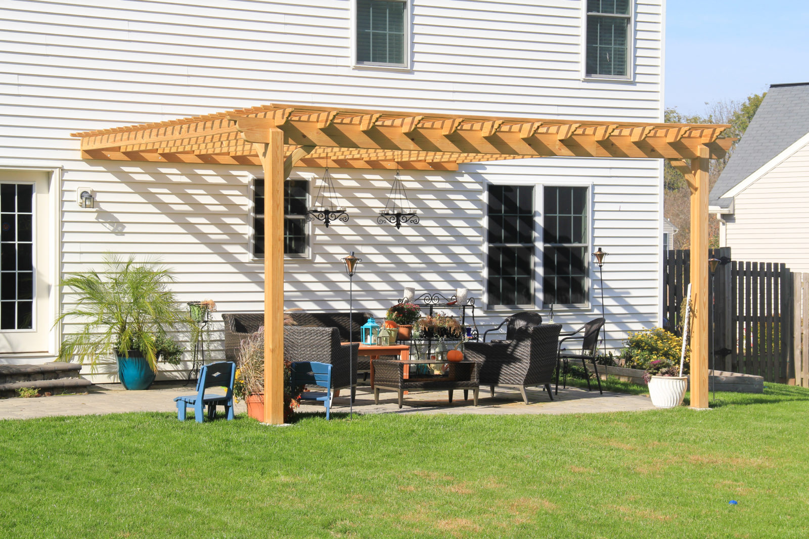 amish built pergola attached to a house