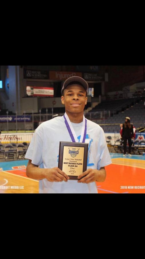 Junior+guard+Jermaine+Taggart+holds+MVP+award+after+championship+game+in+Blue+Cross+Arena.+