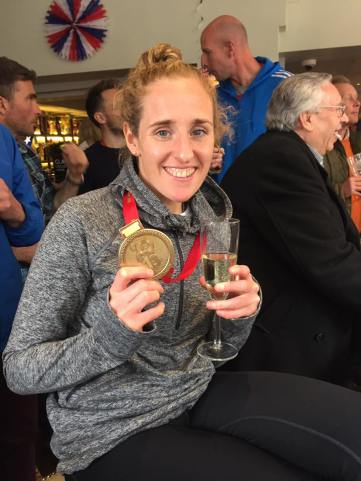 Kate with her medal and wine
