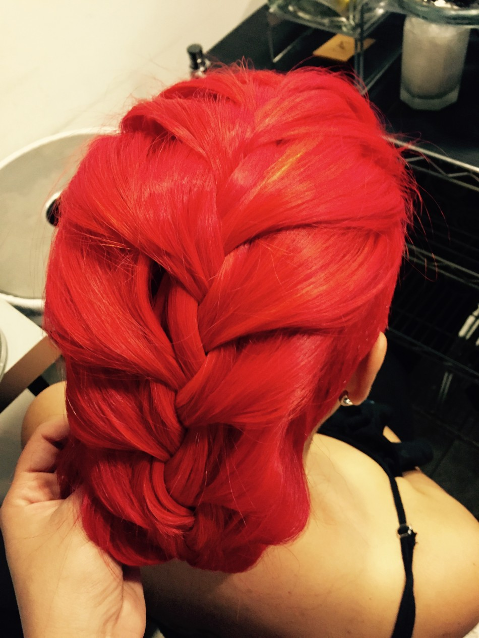 French Braid Hairstyle And Vibrant Neon Orange Haircolor