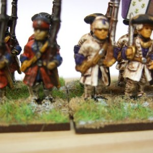 Musketeer advancing shouldered musket forage cap 6 figures