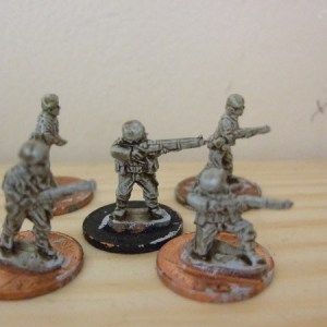 5 various riflemen firing advancing etc all different