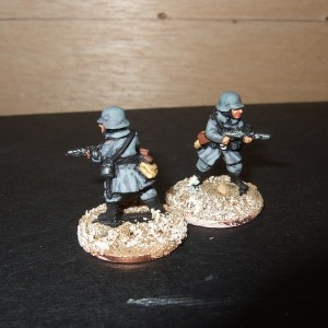 2 Advancing sub machine gunners
