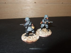 2 Advancing sub machine gunners
