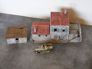 Large farmhouse with lift off floors and roof and grain store.