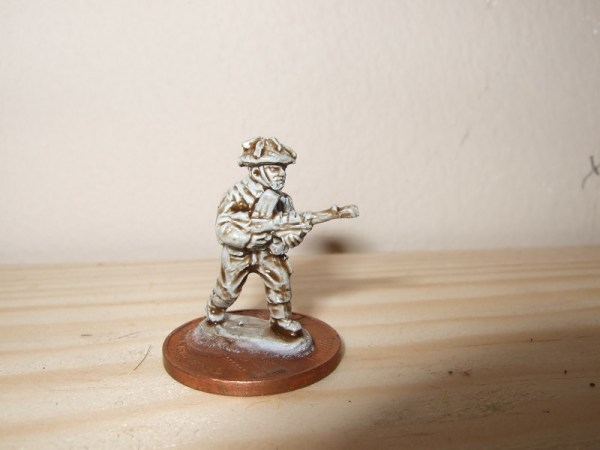 Figure advancing with Bren gun