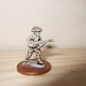 Figure advancing with Bren gun