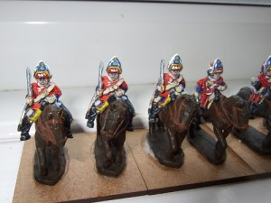 3 Heavy cavalry wearing mitre, sword at shoulder