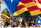 Person holding Catalan blue-starred independence flag at 2012 independence rally