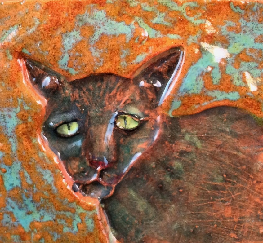 Decorative ceramic cat tile with stand.