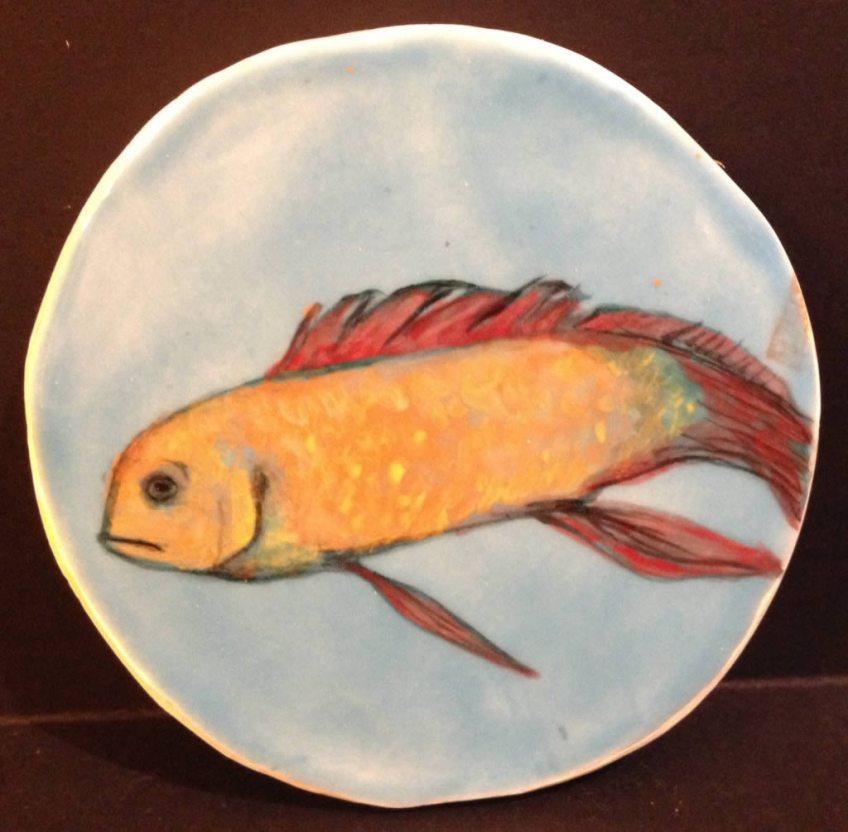 Blue fish decorative item in white earthenware.